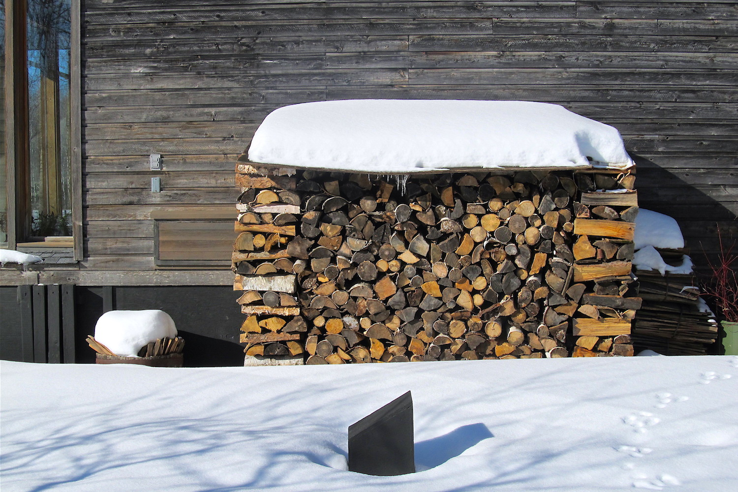 Firewood is used to augment passive solar heat gain during cloudy periods in the wintertime. Depending on the desired indoor temperature, Solace House typically uses +/- two  cords  of wood per year.