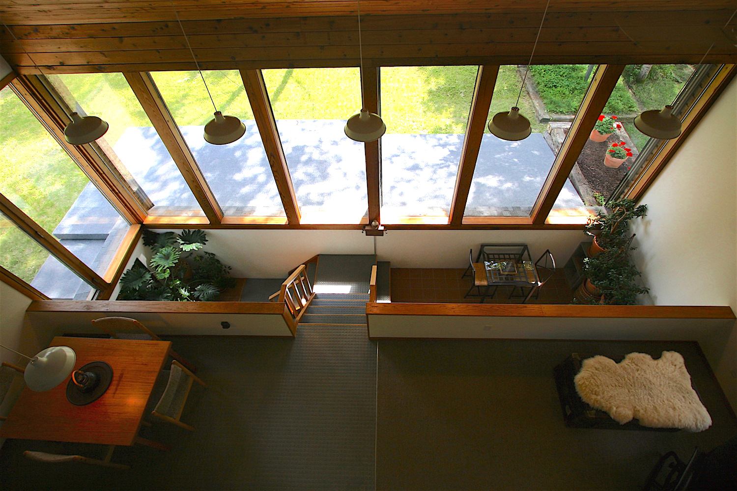 View down from the  sleepspace to the main level and  greenspace  below...