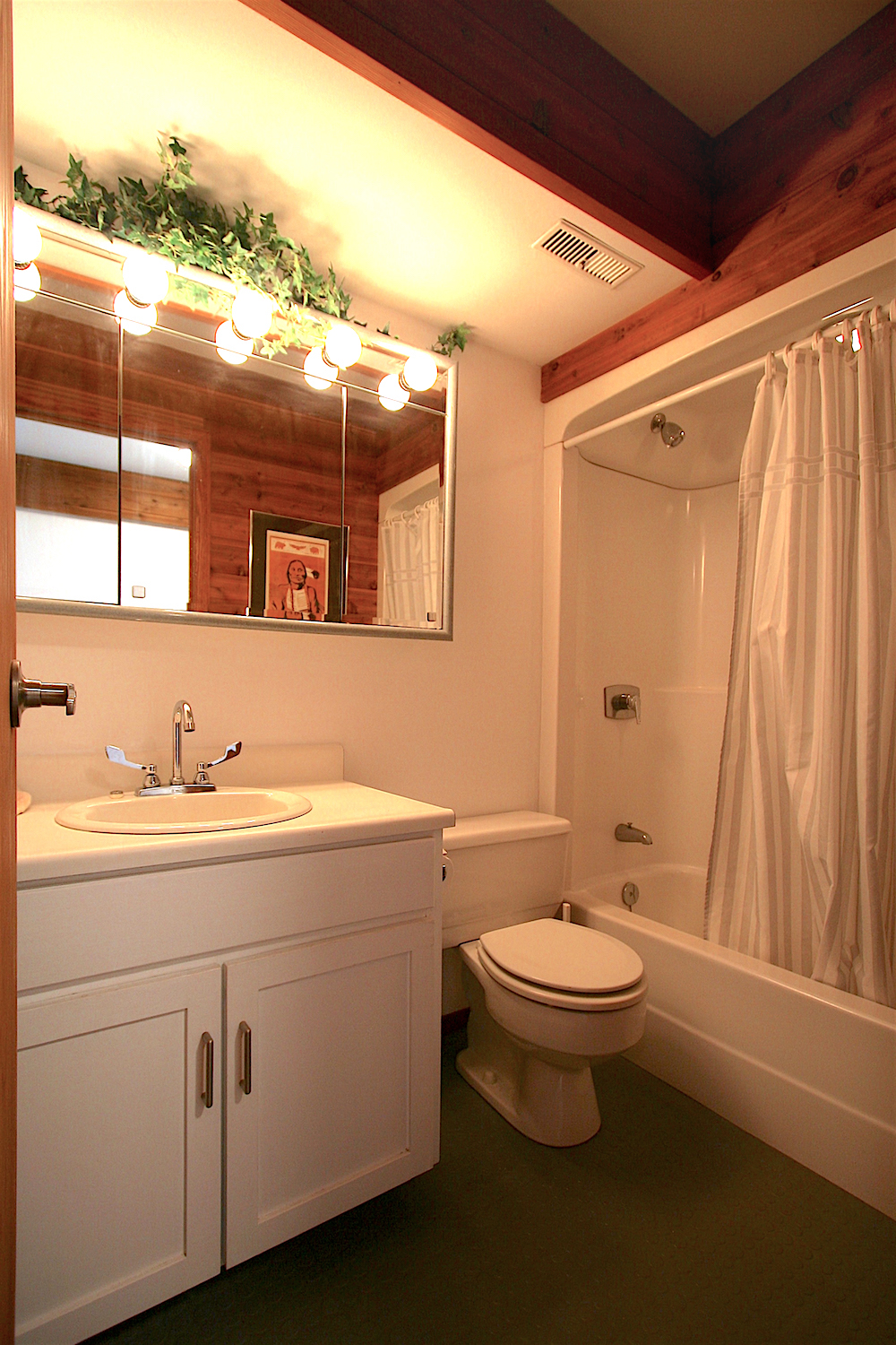 Another view of the full bath on the lower level... with solid rubber gray Mondo® flooring.