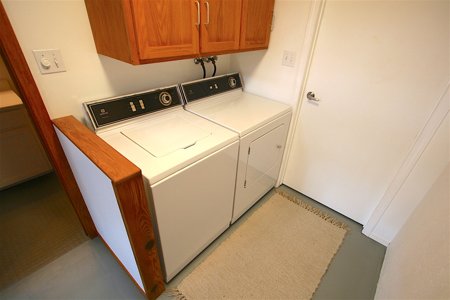 The laundry area and doorway to the utility room... adjacent to the lower bath.