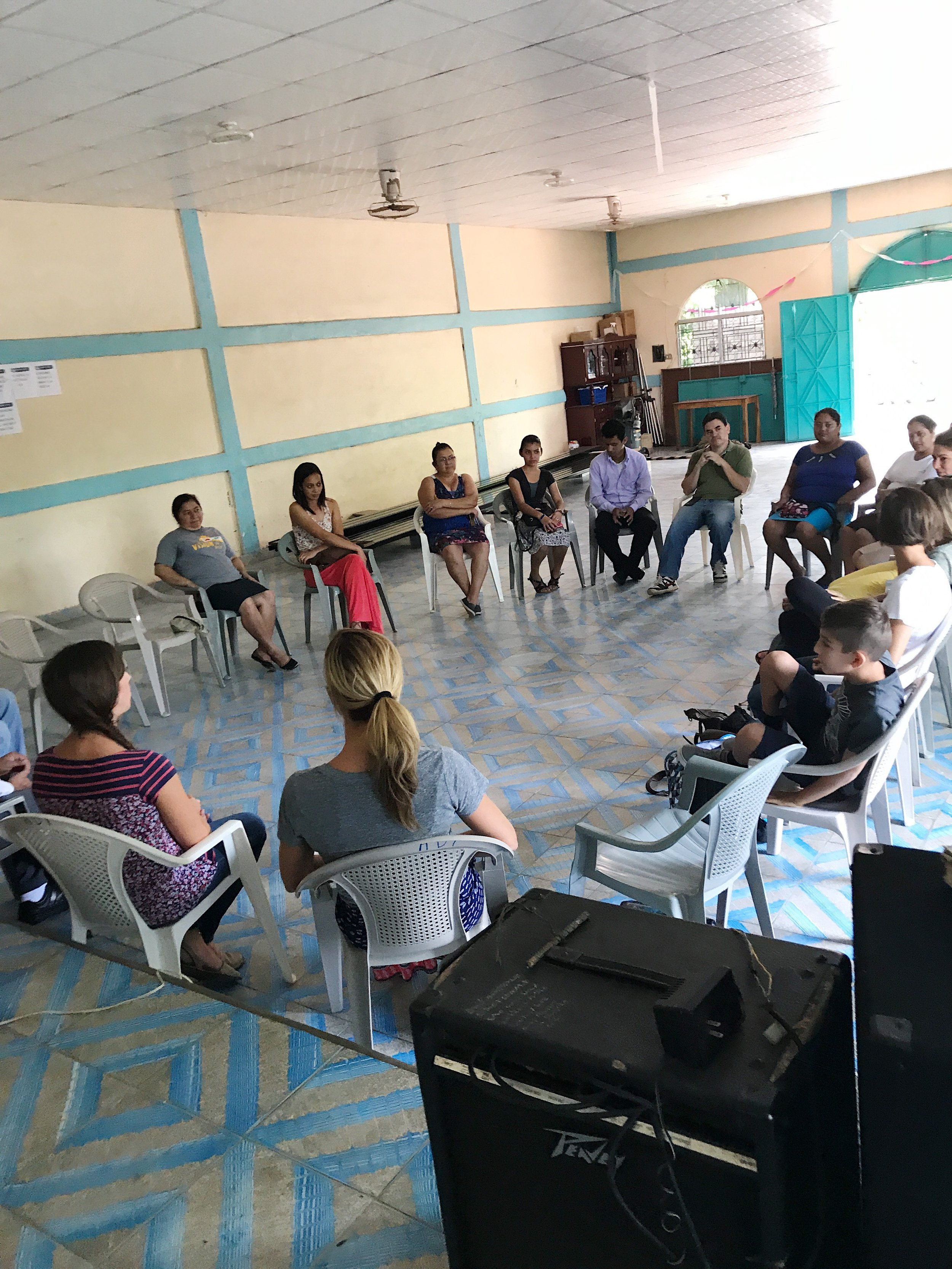 Meeting with church and community leaders working on a water project in Torola,El Salvador.