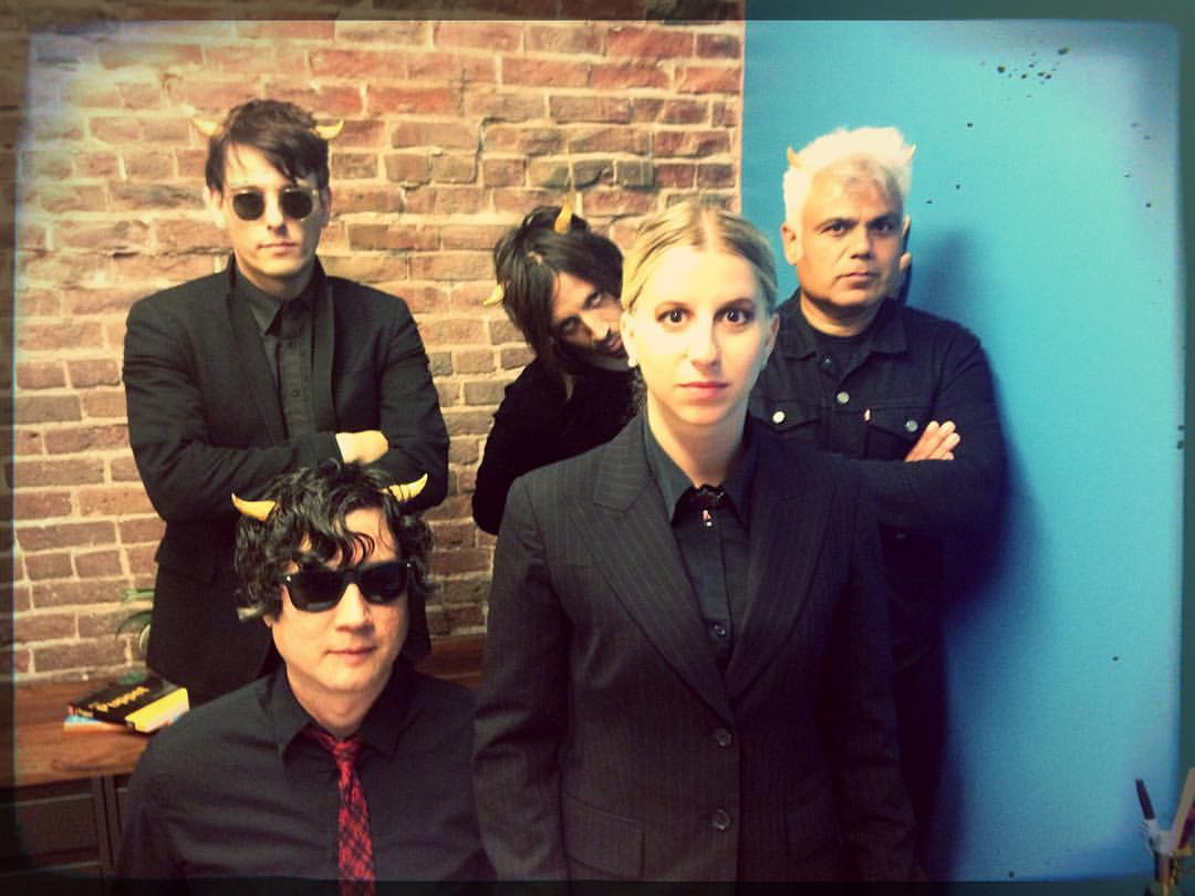 Eric (upper left) and his fellow bandmates from In Letter Form posing with Erma Kyriakos.