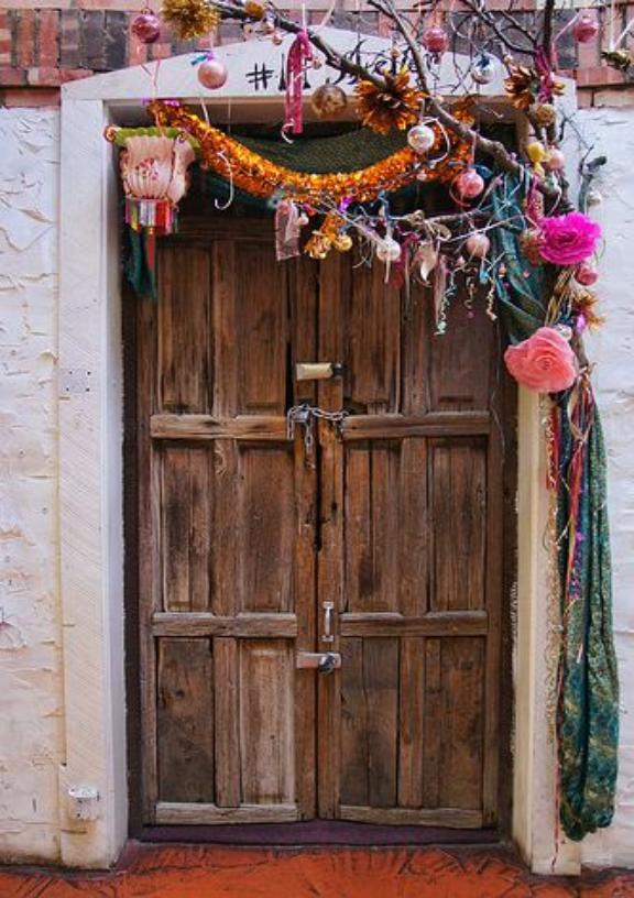 How cheerful and fun does this colorful, historied door look?! I am 99% positive there is a Margarita waiting on the other side. ( via )