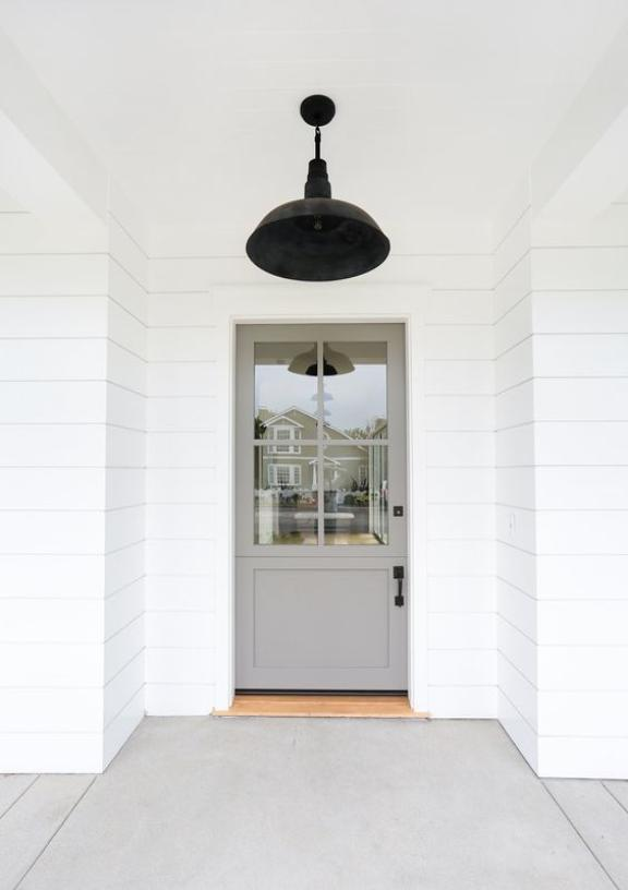 "How ""Modern Farmhouse"" is this sage door? Love the juxtaposition and contrast of the dark light fixture and hardware. Cheers to keeping it simple. ( via )"