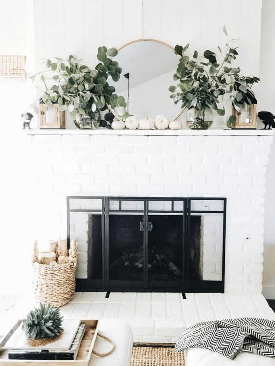 If it weren't for the pumpkins, you may not even know this was a holiday mantle display  VIA
