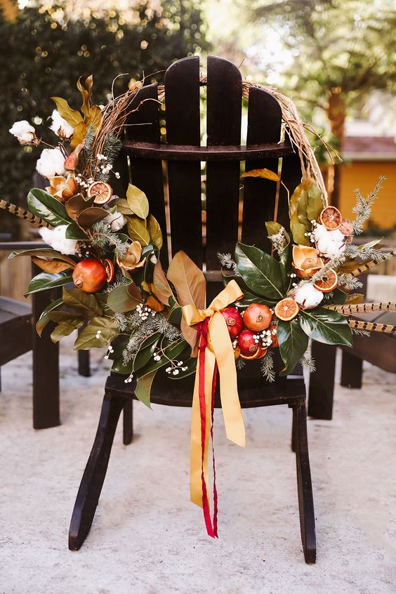 An incredibly gorgeous fall wreath inspired by organic produce and striped feathers  VIA