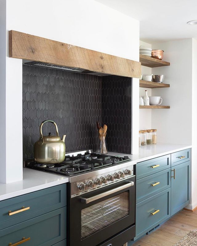 🚨TREND ALERT!🚨Black kitchens are IN right now. Black tile, black countertops, black cabinets, black hardware, black accents... you get the picture. This hue adds a sophistication that kitchens have been begging for since, like, forever. We even have one in the works right now! Can't wait to share (@dptizzle)! 🖤🖤🖤 I cant get enough of the custom tile and black range in @laurenliess's kitchen design 🖤 The dark counters and black accents provide the perfect contrast to the crisp white and organic wood kitchen in @verandainterior's design 🖤 And last but not least - how brilliant and high end is the navy + black combo in @alyssakapitointeriors kitchen design?!