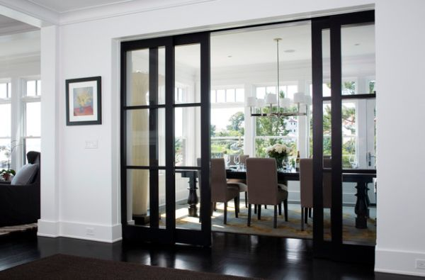 Elegant-dining-area-concealed-by-sliding-glass-doors-in-wooden-frame.jpg