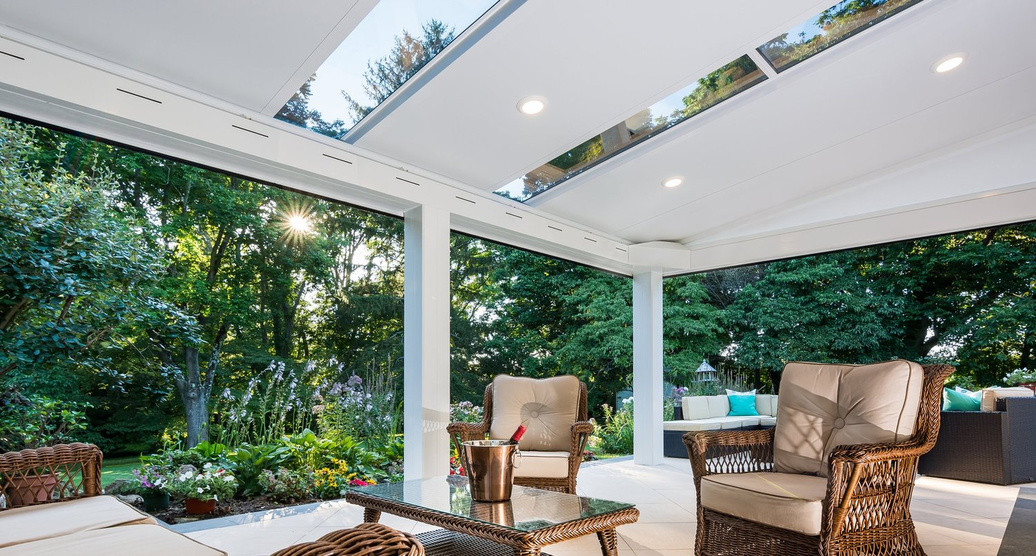 In between a patio cover and a sunroom. -