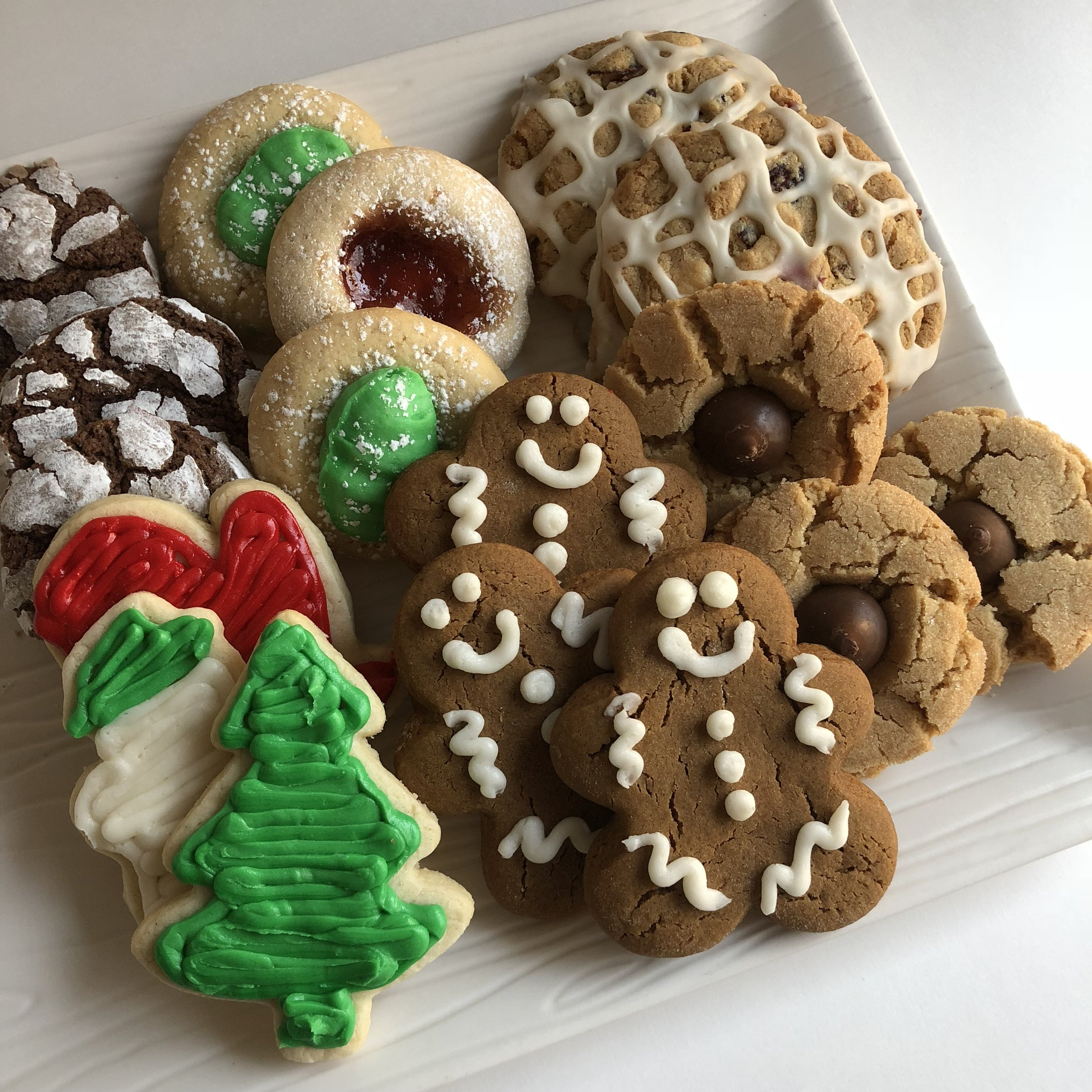 Cookies are a holiday must have! Our holiday cookie tray contains a variety of delicious homemade cookies to make everyone happy. Wrapped in a bow, it makes the perfect gift to bring to any holiday party!