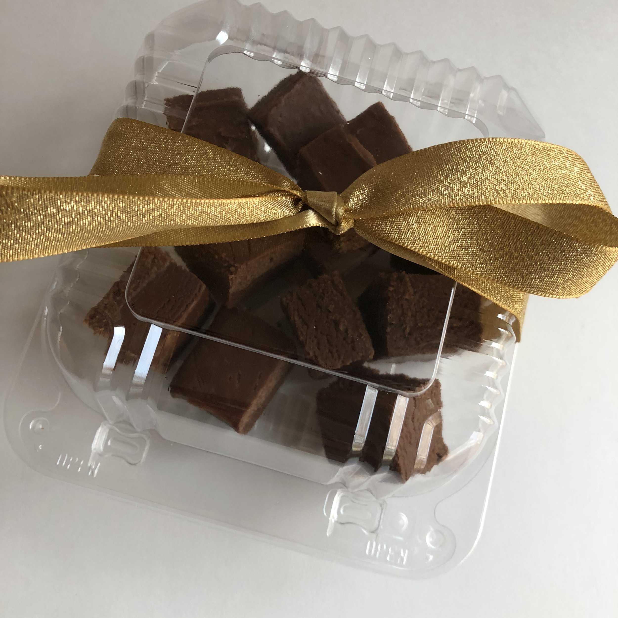 Creamy and rich, our holiday chocolate fudge is simply delicious! Each 1/2 pound wrapped box contains approximately 12 pieces of fudge. Perfect for any chocolate lover!