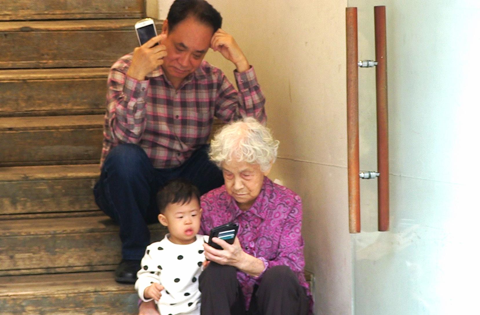 Grandparents with grandson at Namdaemun market