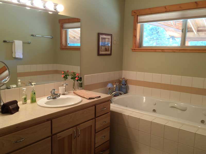 Full bath with jetted tub and shower.