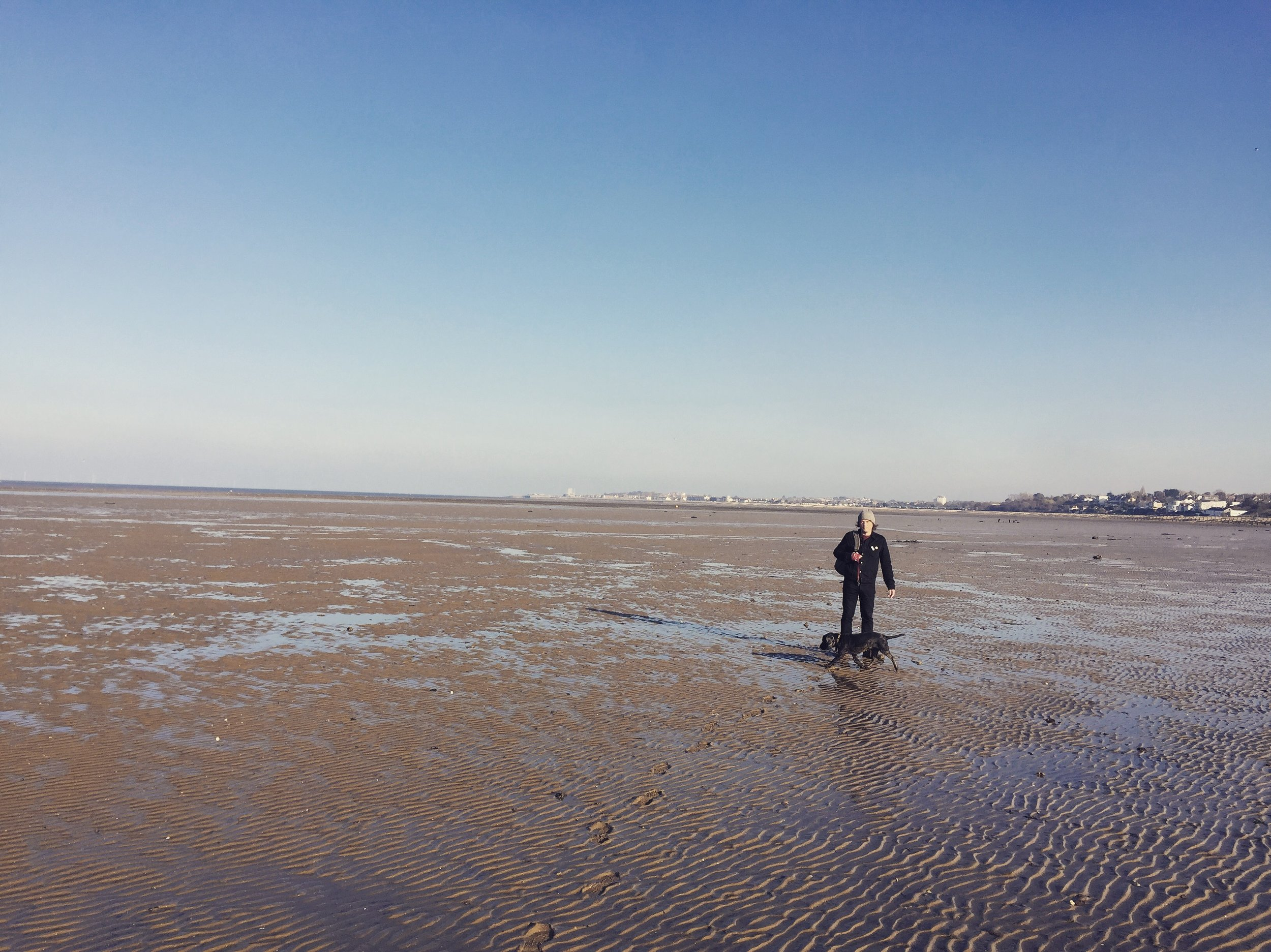 Gareth E. Rees, and Hendrix, on the mudflats at low tide, Thames Estuary, approaching Whitstable.