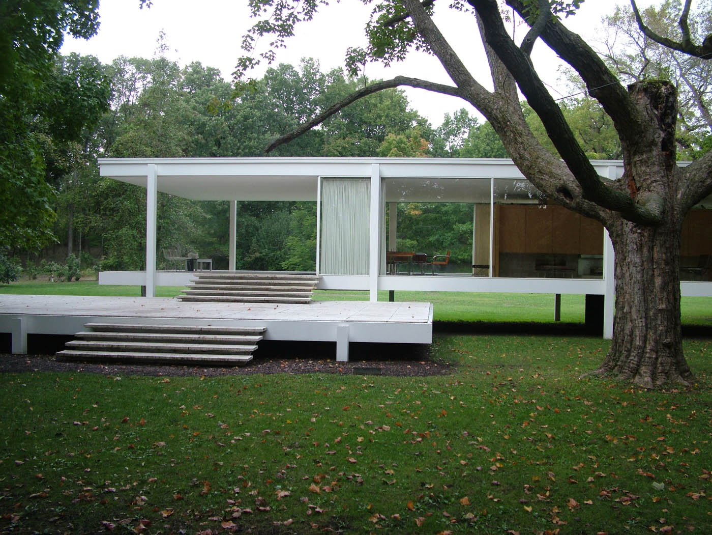 Farnsworth House by Mies van der Rohe has glass walls with a timber core for living, full length curtains for privacy.