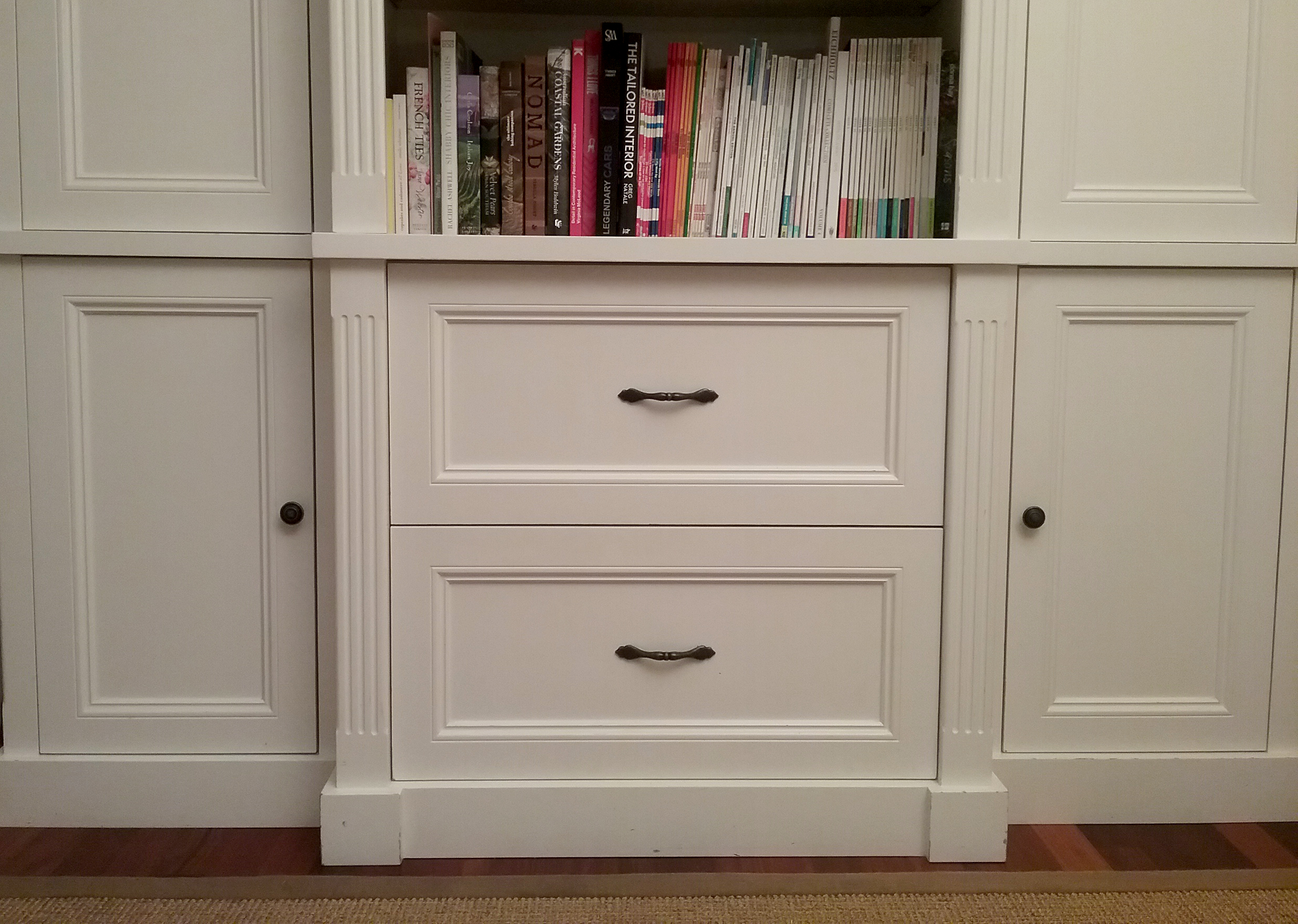 Custom Storage   The stunning custom bookcase is fitted with deep drawers for effective storage.