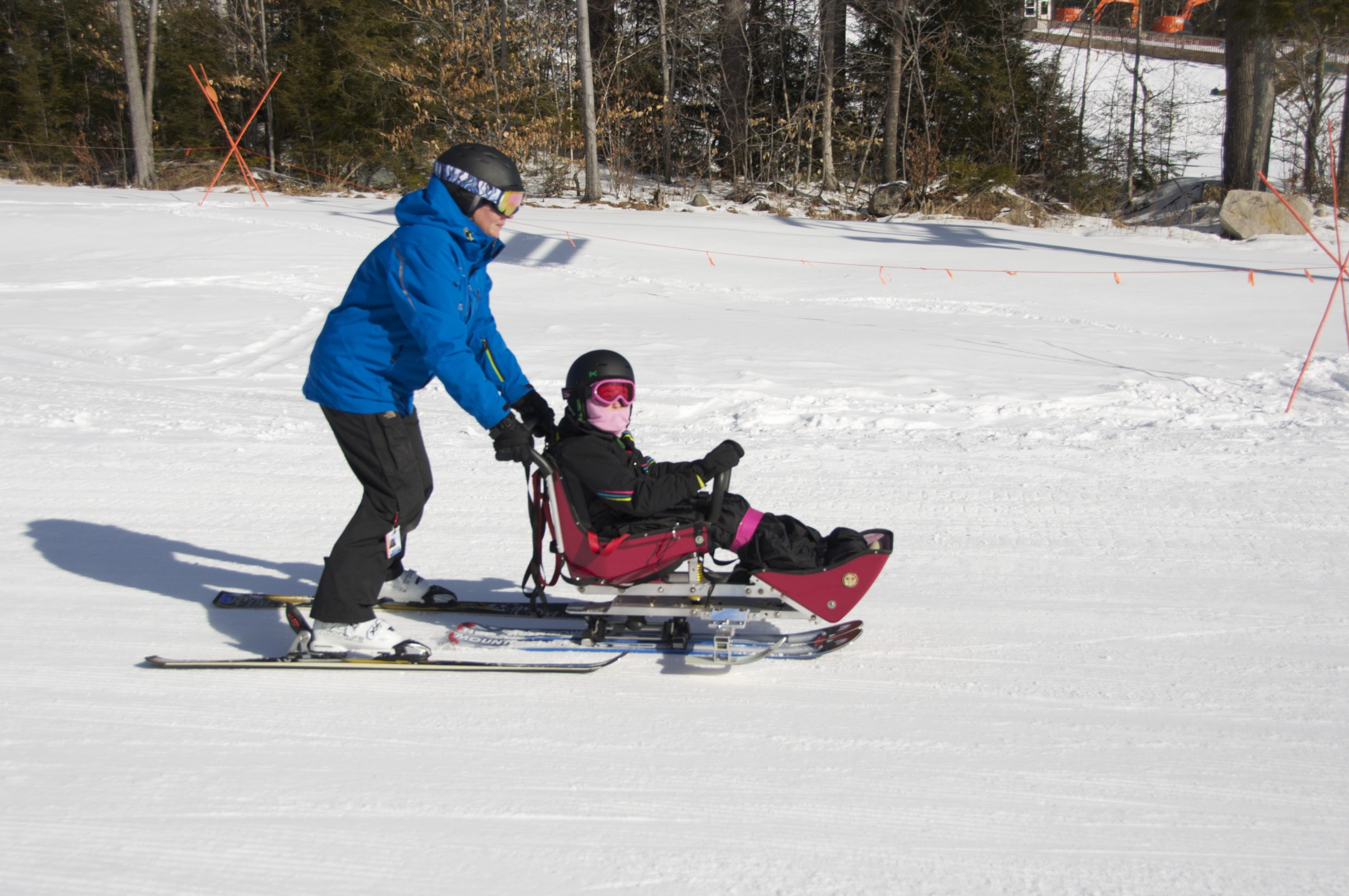 Paige Davis guides a bis-ski student back to the lift.