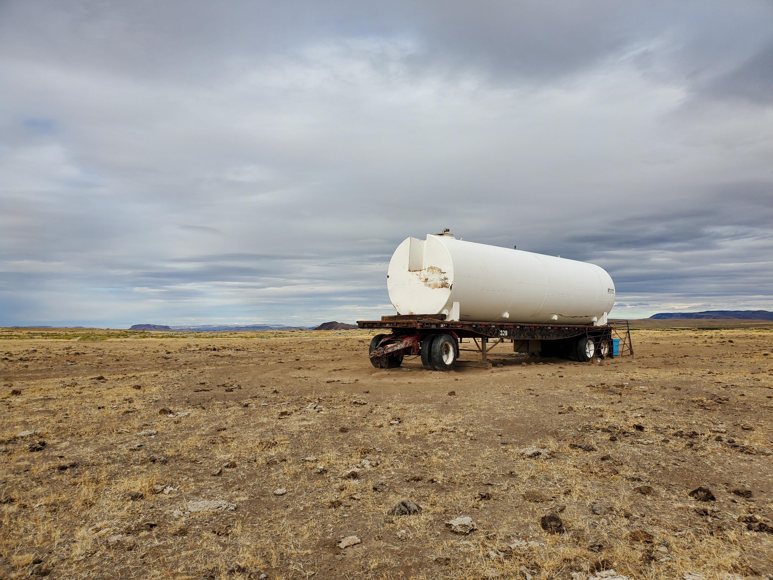 A random water truck in the desert, unfortunately it was dry as a bone.