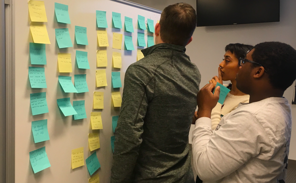 Team Members Chris, Ife, and Irene categorize Veteran insights