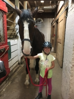 Bud, our gentle giant, with one of our smallest campers!
