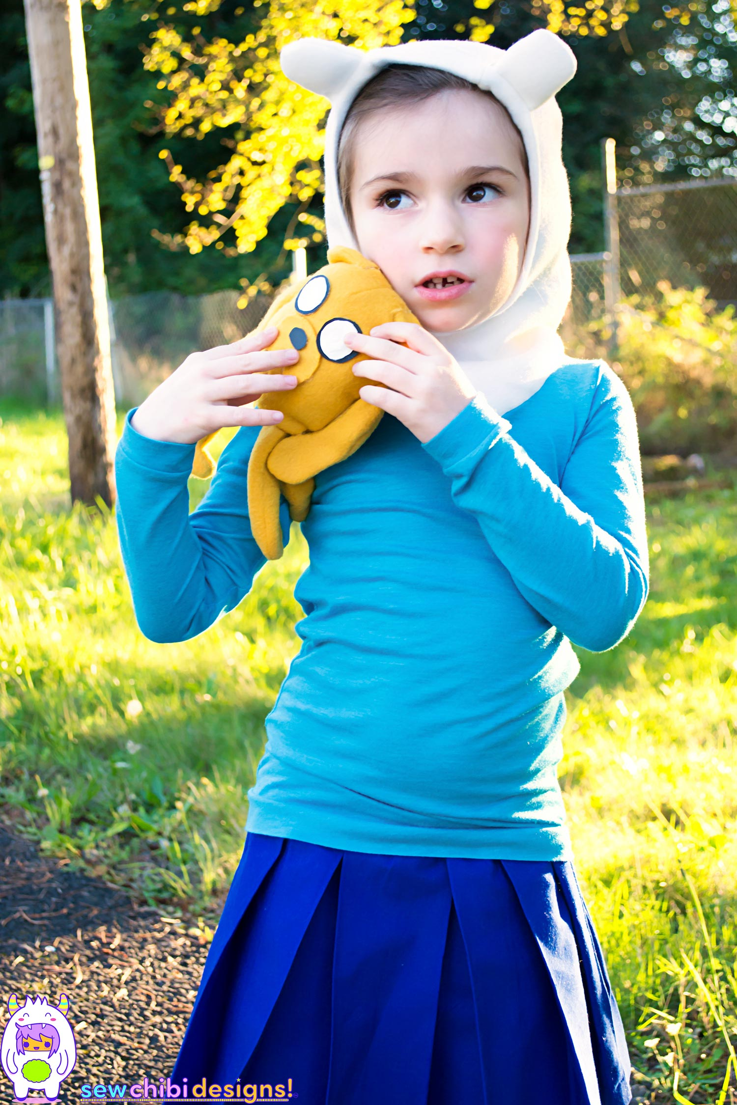 Chibi cosplay of Finn + Jake from Adventure Time sewn by Sew Chibi Designs for Halloween featuring the Bimaa Sweater PDF pattern