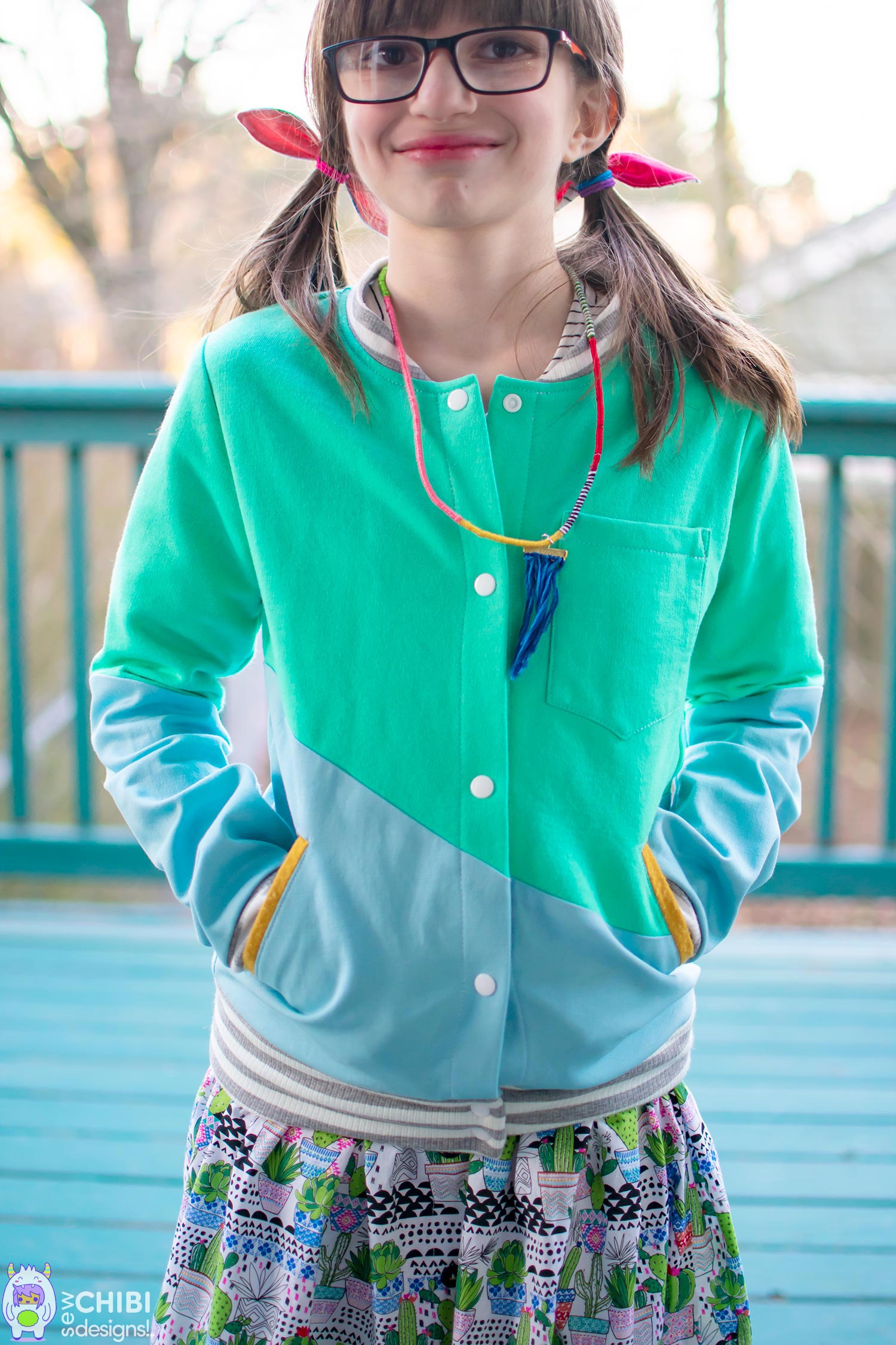 Ichigo Bomber Jacket - • Color-blocked wave effect• Easy welt pockets• Fun applique' back with Hiragana and English lettering• Chest pocket• For boys & girls ages 12M- 16Y!