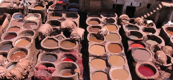 ceramic pots with different coloured dyes, from black to brown to dark grey.