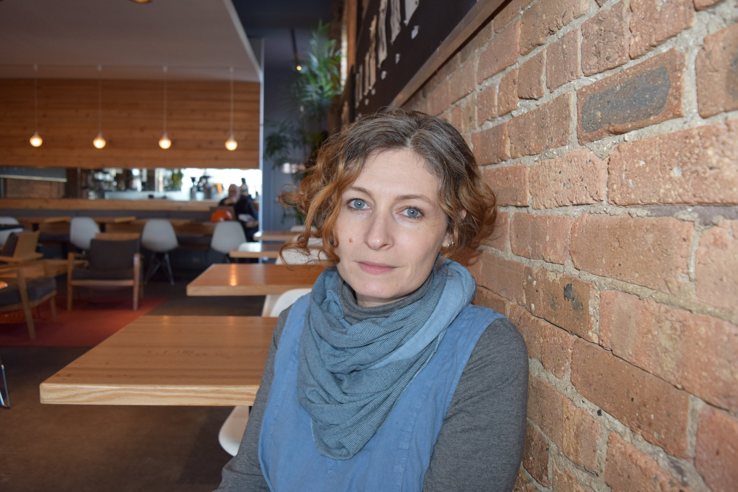 "Lee Corrina Cano   Co-owner, The Coffee Studio    ""We opened the Coffee Studio here in Andersonville because we love this neighborhood.  We've lived here for over 11 years, and we've really wanted to be part of the local, mom and pop, independent, boutique businesses that are here.  We love the people here, and this neighborhood is pretty amazing in how walkable it is.  It really feels like a little bit of a European city, and we pretty much never leave."""