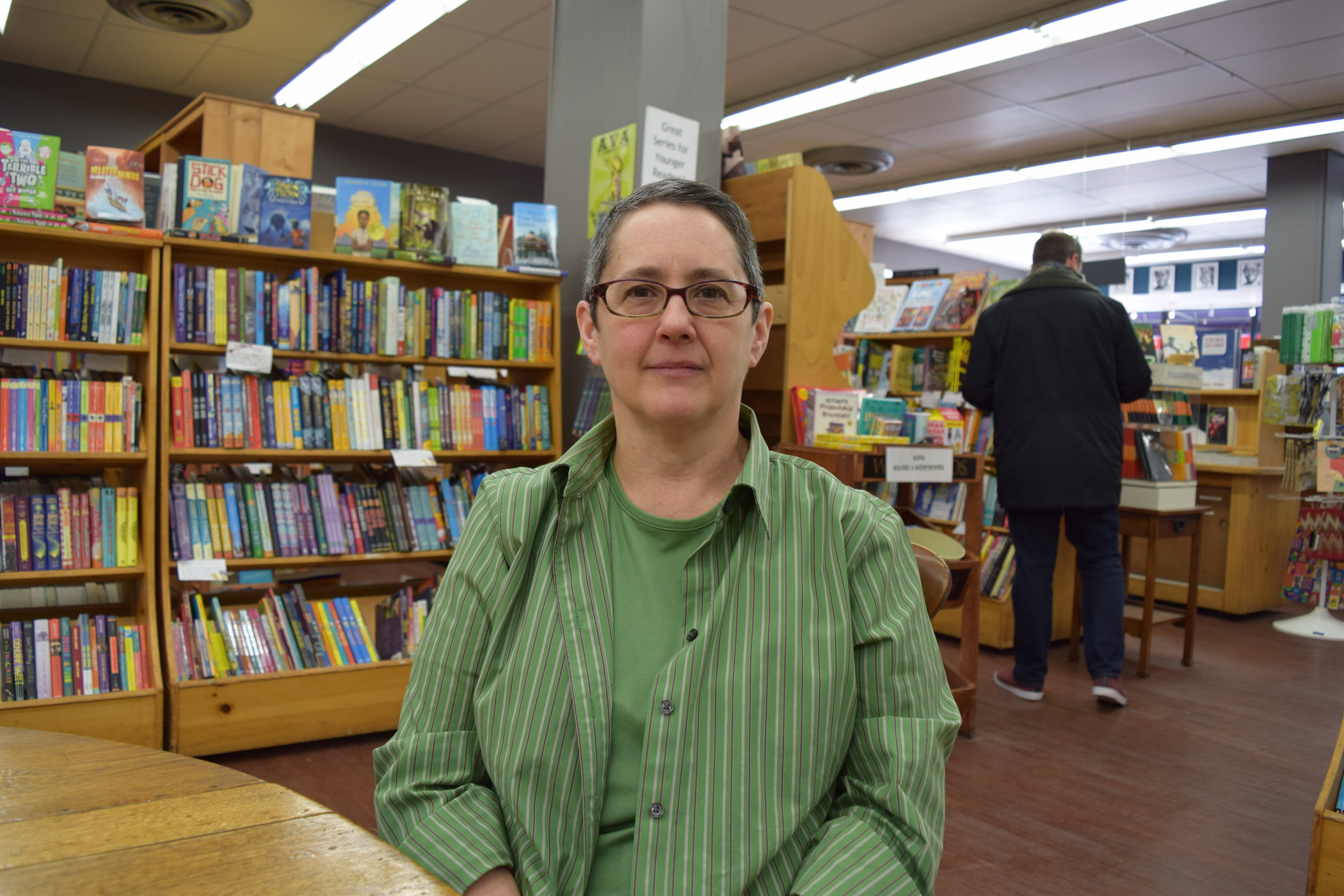 "Lynn Mooney   Co-owner, Women & Children First    ""Being a bookstore is the core of our business, but we also know that any book found on our shelf can be found elsewhere.  The book that someone buys online from another business is the same book that they might find in our store.  And we can't get away with that.  We can't beat Amazon on price.  We just can't, so our one-on-one human interactions are part of our point of difference.  That could be the moment that we put a book in an adult's or child's hand and talk to them about it.  But it's also the events and programming.  As we say, Amazon still hasn't brought your favorite author to Chicago, to your neighborhood to read to you, or answer your questions live in person.  That's not something they can do or will do, but we do that pretty much every day."""