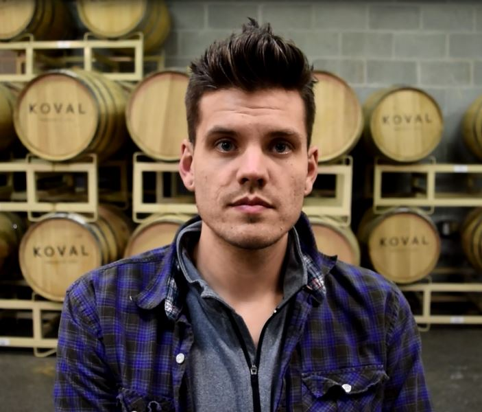 """Jacob Hukee   Store Manager, Koval   """"What makes us a little different and unique than other batch distilleries, and especially against larger companies, is that we're a grain to bottle company, which means we actually produce everything in house…It's all part of a neighborhood that focuses on the arts, focuses on craft industry, as anything from beer, food, table-making, furniture. It suits the personality of our company."""""""