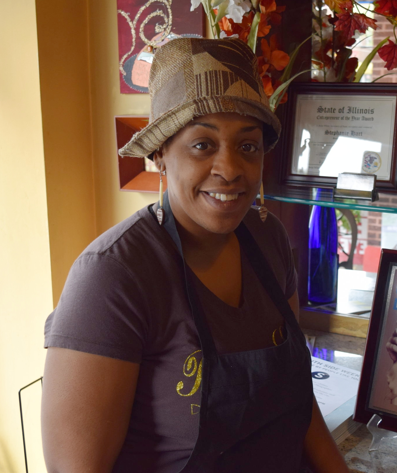 """Cherita Whitehead   Store Manager,Brown Sugar Bakery   """"Brown Sugar Bakery is more than just a bakery. We are part of the community of 75th, which has a bunch of talented entrepreneurs. The cake pretty much sells itself. We just have to be really good on our customer service…I live and work in this community. It's safe, and the people are cultured. There's a lot of art and music. Our neighbor [owner of Looks & Styles] is a singer, rapper, and designer, just to give you a sense. I love 75th Street. I think we're up and coming. I'm hoping to see 75th Street look like Hyde Park sooner than later."""""""
