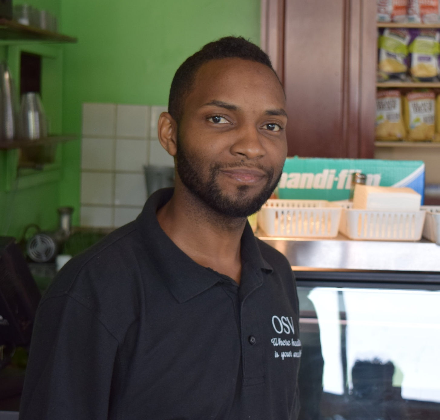 "Arel Ben Israel     Owner, Original Soul Vegetarian        "" We've been here for 35 years now.  My dad opened this business because he realized that most of the illnesses that existed, whether its high blood pressure, diabetes, strokes, stress, high cholesterol, the African-American community was attacked by them the highest.  Because he changed his eating habits fifty plus years ago, he realized that some things changed within his own body.  So, he came up with the concept of a vegetarian restaurant.  He went from eating a traditional American diet, which was everything, to saying, 'Let me challenge myself to a new way of eating'…Since then, we've just been developing and expanding in the vegan food industry.  We're the first vegan restaurant in the Midwest.  We took what most people liked in the American diet, whether it was hamburgers, gyros, BBQ, and we made it all vegan…On a local standpoint, we don't have as many options as we should, to be extremely honest, in the Black community.  That's why they came up with the whole idea of food deserts.  Because they took a snapshot of neighborhoods, and some neighborhoods was better supplied than others.  It just so happened that on the South Side of Chicago we was deprived from fresh food, fresh vegetables, decent places to eat, decent places to go, places you can actually trust the products or the services they bring to the neighborhood, so from that standpoint it's breathtaking.  It's like a glass of fresh water that you're kind of nourishing the community and connecting with people that normally wouldn't even hear about it."""