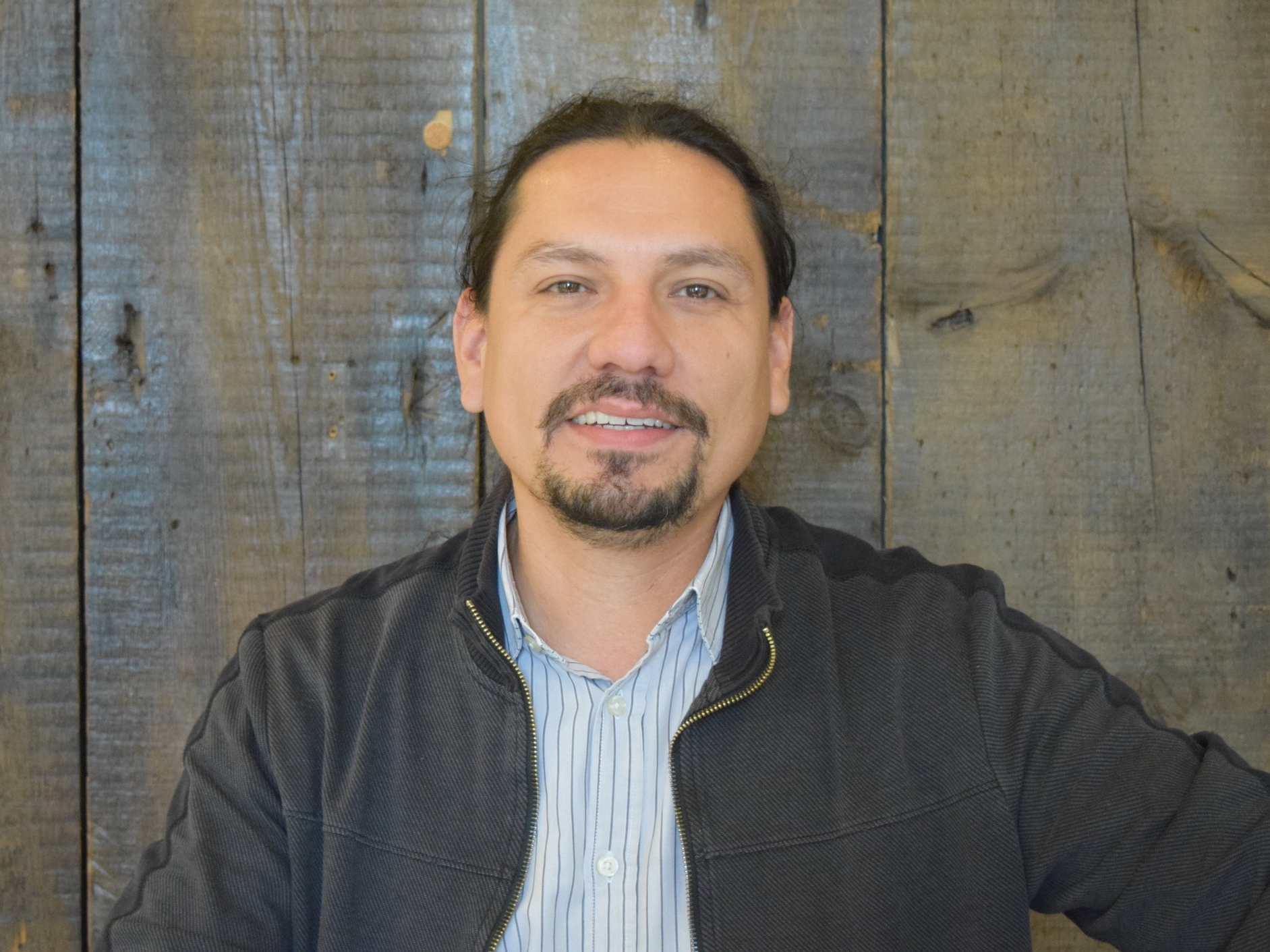 "J. Omar Magana   Executive Director and Founder, OPEN Center for the Arts   ""For the community, I think it's very beneficial as we are one of the only galleries in the community.  Basically, what we focus on is making sure that there are arts in the neighborhood - always exploring ways, always sharing what we know and working together to expand the creativity in the neighborhood.  We're connected with several of the organizations around here.  We're in a coalition called the Marshall Square Resource Network, made up of all the organizations from the neighborhood.  What they do is unite all the non-profit organizations from the neighborhood, so they can get together and everyone can share resources.  It becomes this powerful network.   So if you need some art, it's over here.  If you need some medical stuff, legal stuff - whatever it is that you need, everyone does something different, which is pretty awesome.  And by doing that there is an awesome energy in the neighborhood.  To know that we're part of that, it's amazing…Right now we have a theater program that we manage, Teatro Americano, which was created by Latinos Progresando.  They explore ways to make plays related to current events and current situations in our neighborhood.  We also have some dance classes called 'I'm a Dance'.  We are pretty much just trying to get a little bit of energy, a little bit of fun, and just loosen up a little bit and learn something different.  We have art classes that we do for free with the support of the Lincoln Park Zoo.  We're exploring ways to explain the environment, the wildlife, and the ecosystem through art.  We also have a leadership program.  It's called 'Hola'.  What they do is try to explain to people the power within them and figuring out a way to encourage them…Ever since I was a child, this was the place we would always come to to get the things we need as Mexicans. It's the second largest Mexican community in the United States.  It is amazing. To walk down 26th St. you see it's all mom and pop shops.  Every time you go in, you're going to connect with someone, and it's going to feel like a small town."""