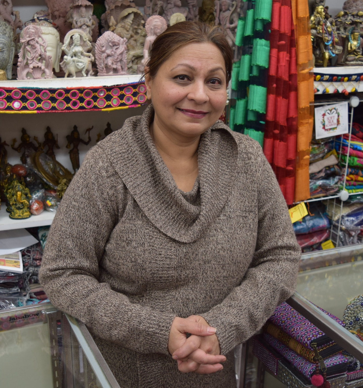 """Huma Mahtani   Co-owner, Reshams   """"We've been in business almost 30 years. We have hand-crafted goods from Indian, mostly handirafts, pillows, wall hangings, and tapestries, yoga related and meditation related, holistic healing kind of things…I grew up here. I love it. I was 12 years old when I came to America. I grew up on Devon Avenue actually. You have all different nationalities - that's the best thing about it. It's a fun neighborhood to be in. Everyone gets along. We love each other."""""""