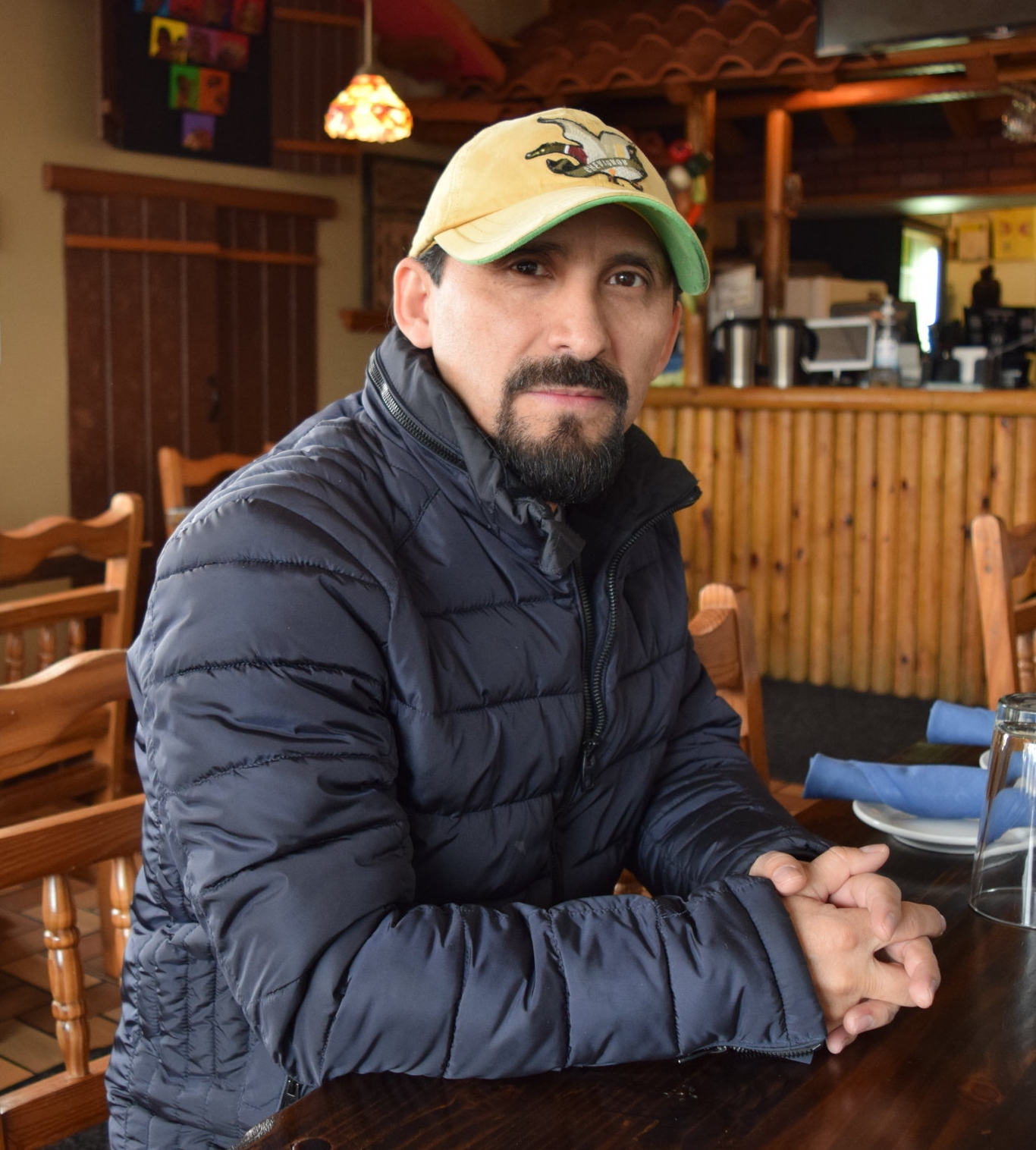 "Elio Erraez   Co-owner, Sabor a Cafe   ""We've been here 17 years at this location.  Basically, we try to work with the community because this restaurant is not just for Colombians, but it's multicultural. My wife is the chef, and we have traditional recipes from generations in the family. We've been hosting live music for more than 10 years, working with local bands and international musicians as well. People sometimes don't realize who's playing in the back.  Believe me, they are amazing musicians. They are monsters of music from Cuba, Brazil…people don't realize because they are not well known in this country – but they are in their countries. That's my commitment to introduce them through this place. We've been doing not just music but workshops for the neighborhood.  We have art expositions and book readings.  This is a restaurant and cultural center."""