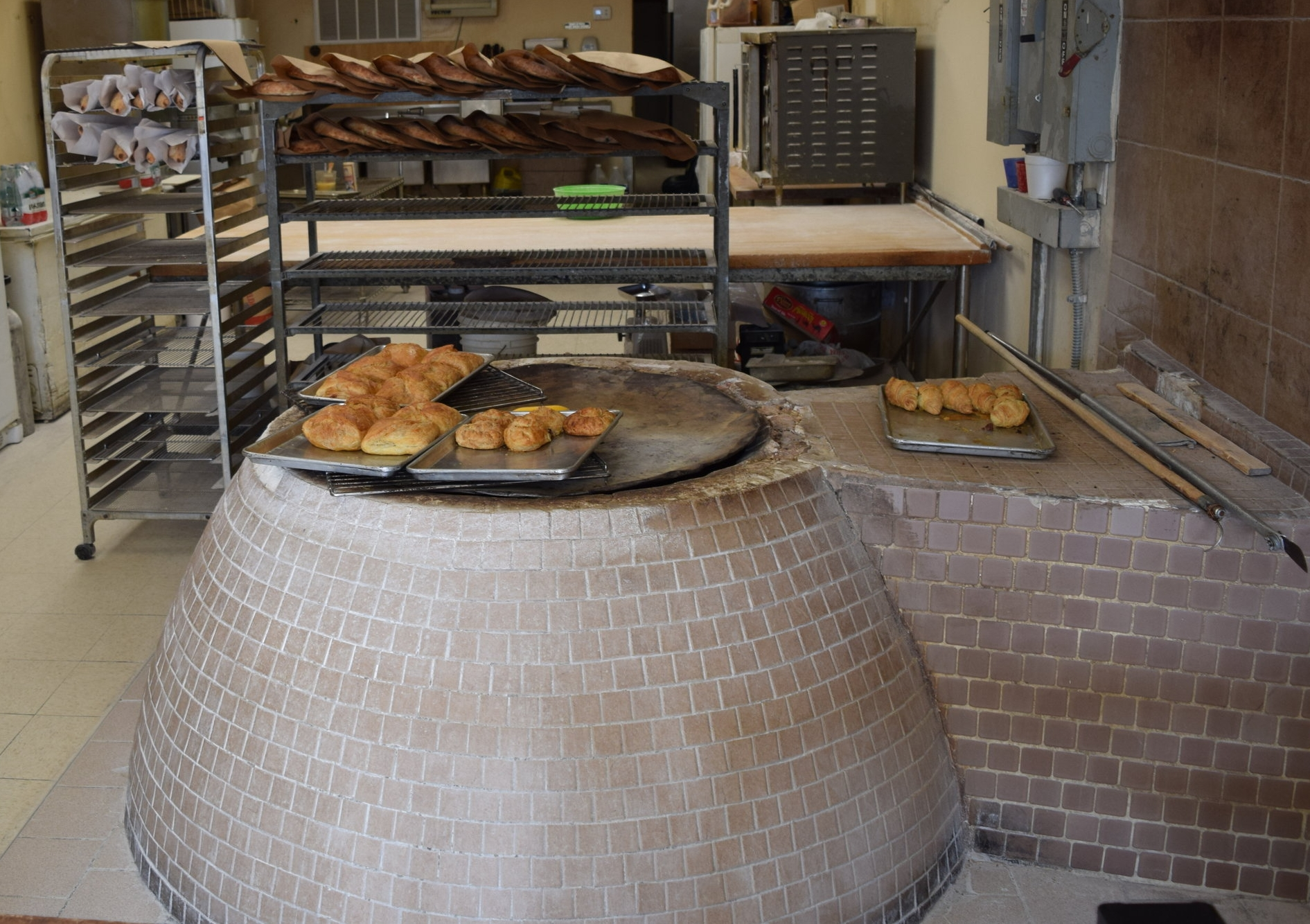 "Alex Manujevich   Owner, Argo Georgian Bakery   ""We opened in 1996. We have a traditional Georgian oven, and we bake traditional Georgian bread and different pies here. Dumplings and everything, we make it here…When we opened, it was mostly a Russian neighborhood.  That's changed, but we're still alive. Everybody comes in - I don't prefer any nationalities. Everybody likes it. People come from all over because people find us online. They come from all the states around and all the states in America. When they get a chance to visit to Chicago, they stop in."""