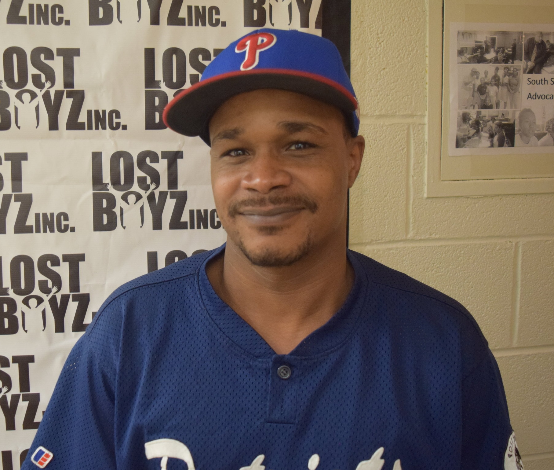 "LaVonte Stewart   Executive Director, Lost Boyz Inc.   ""We started LostBoyz in 2008, officially in 2009 when we became a non-for-profit 501c3. As an organization we started in response to the spike in violence that we saw in the community among youth. I had already been coaching Little League for the local league that had been defunct for about two and a half decades. It was the one that my peers and I grew up in in this community. So when it folded I was really disappointed and I was stuck with this group of about 15 boys, [ages] 11 to 12. [While] I was telling them that things were coming to an end, and I was going to help them transition into another league, to one of our league mates in the district like Jackie Robinson West or South Side, we experienced what I considered to be a traumatic incident. It was middle of the day in the summertime on a weekday. While I was talking to them, we see two guys pursuing another guy across the field and they have guns. I'm kind of old school, and I hit the dirt. The kids are kind of laughing, talking, taking bets on if they were going to get the guy. At that moment it really hit me like a ton of bricks how desensitized to the violence the kids had become. There was just this mixture of emotions for me. As an adult who was working with them, there was a protective factor and this 'Oh my God. Maybe this is more than I can deal with'. As a person growing up in the community and having lived that life, there was also a sense of guilt that I had overall contributed to this transformation of our subculture. So I wanted to contribute to changing that narrative or that paradigm of what was happening. So from there, I was thinking about it, and that's where the name came from. We had lost these kids. Where are all the adults? The people standing in the gap for the kids? We're lost spiritually, mentally, emotionally. It was less of an indictment on the kids and more of an indictment on the adults in the community. So that's how it came about. We've been going pretty strong since then. We started with 15 boys. We're now up to a total of roughly 130 kids. Of that 130, about 14 of them are teenagers who have been in the program since they were younger and are now too old to play. We created a second program for them which is a continuation of service called Successful Youth Leaders, where they act as youth workers. The rest of the kids are playing baseball or softball. This is our fourth year incorporating fast-pitch softball for the girls. We saw these same negative behavior patterns with girls that often revolved around violence and interpersonal conflict and in some cases it was worse than with the boys. It was an easy decision to bring the girls in…South Shore itself is an absolutely beautiful and wonderful neighborhood. It has a very rich history. We have so many jewels and assets in this community. It's a transportation hub. It's a really wonderful mix of wealth that's in this community. It's what makes it so interesting. You could be on one block , and it's a moderate block, and you could go over two blocks, and you'll run into baby mansions, and then you'll go over two more blocks and it's dirt poor. It's a really interesting mix of income levels. We have really notable people who come from this community. It's very resource rich in one aspect. It's a community that's now trying to rebound thanks to people like Yvette Moyo (publisher of  South Shore Current Magazine ) and posthumous Henry English, founder and leader of the Black United Fund, and Victoria Brady (founder of Ray of Hope Center for the Arts) who do wonderful things for the community and are trying to resurrect it."""