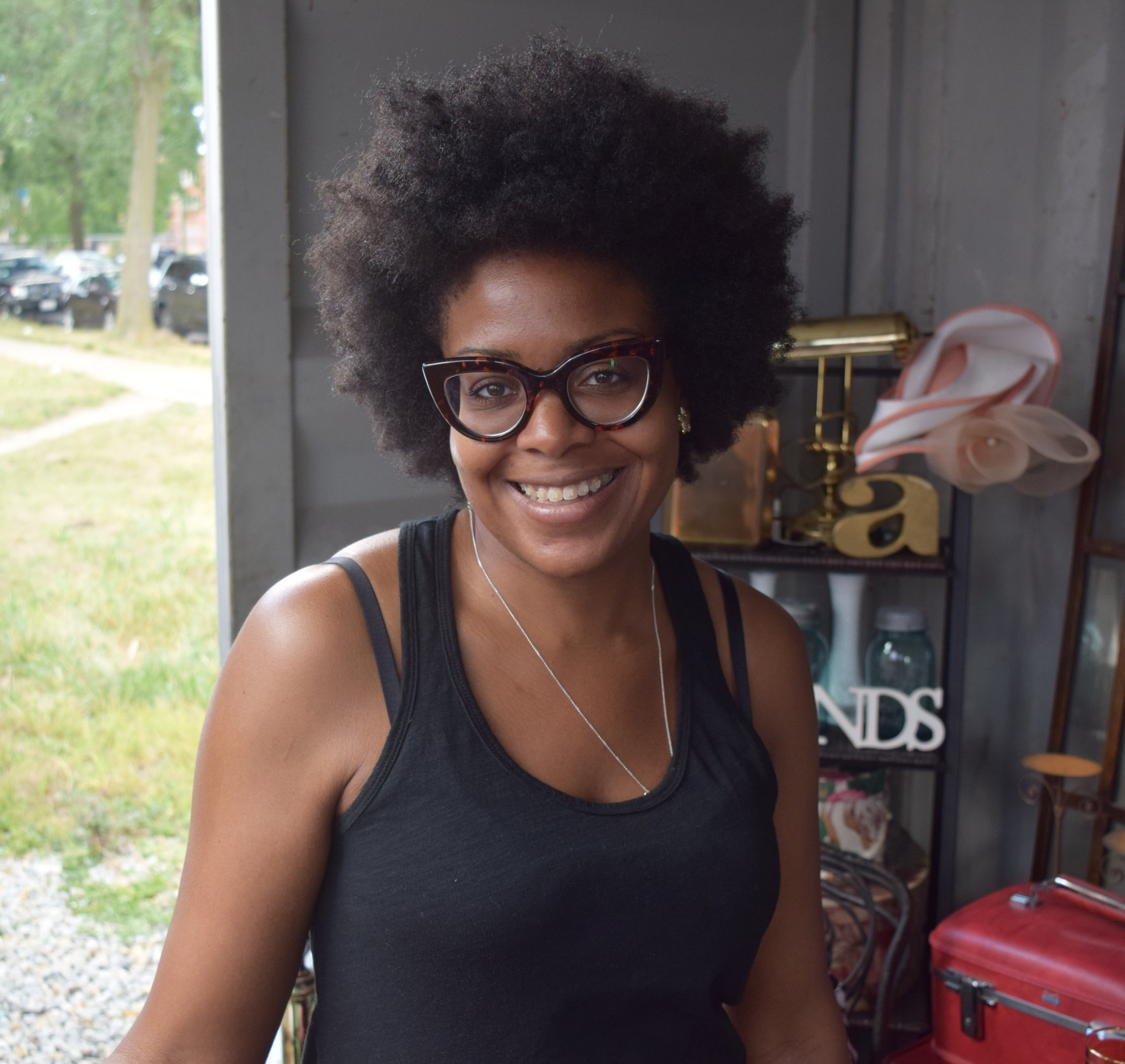 "Michelle Merritt   Owner, Aplomb   ""We are a vintage lifestyle boutique. Our container contains everything vintage. For me it's about getting people to incorporate vintage into a modern lifestyle. We have clothing for men and women, home décor, barware, and anything you can think of that's vintage from the 40s up until the 90s, which is very scary to think of 90s as vintage, but it is…For me I love Bronzeville because of the history. It was one of the first stops that blacks made during the Great Migration. I feel that the soul of that history is still here. I'm looking forward to what the next generation is going to tap into and to continue bringing great things to the community."""