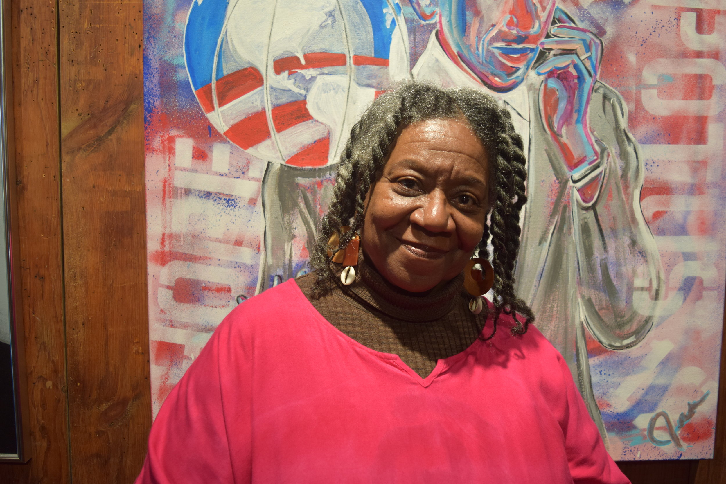 """Maséqua Myers      Executive Director, South Side Community Art Center   """"""""We are the oldest African-American art collective institution in the country. We are a part of the Workers Progress Administration initiative, so in 1940 we became one of the 110 art centers that was assisted in founding and opening. We are the only ones that are still standing in the same location, with the same mission after 76 years. We never closed our doors. We continuously bring art experiences to this community, to the nation, and we actually have international reference and acknowledgment as well. We are carrying on the legacy of using our art to educate and to bring people together and also use it as an affirmation of the African-American artist in particular. One of the reasons why the South Side Community Art Center exists is because of racism. It's because of in 1940, there were no galleries that would hang African-American art. There was one guy named Peter Pollack who had a gallery downtown that hung art for arts sake in term of its beauty and prominence. With him involved in the South Side Community Arts Center, we were able to negotiate and be a part of the Workers Progress Administration… We're more than just an art gallery. We're a multidisciplinary school. Not only do you come to see exhibitions of art, you get chances to take classes in writing, acting, and poetry. We also have programs in the evening where we have open mic and spoken word events. We're also a community center. We're here for the community, which means we support whatever the community wants to speak on. We're right there for social injustice situations, and I think that is what has kept us alive because we've kept the pulse of the community at heart. So whenever there's something to talk through, any kind of plans of action for the better, it happens through here. We've gone to the jails, we've gone to the schools to bring art. We know that art can change a person's life for the better, and it can also br"""