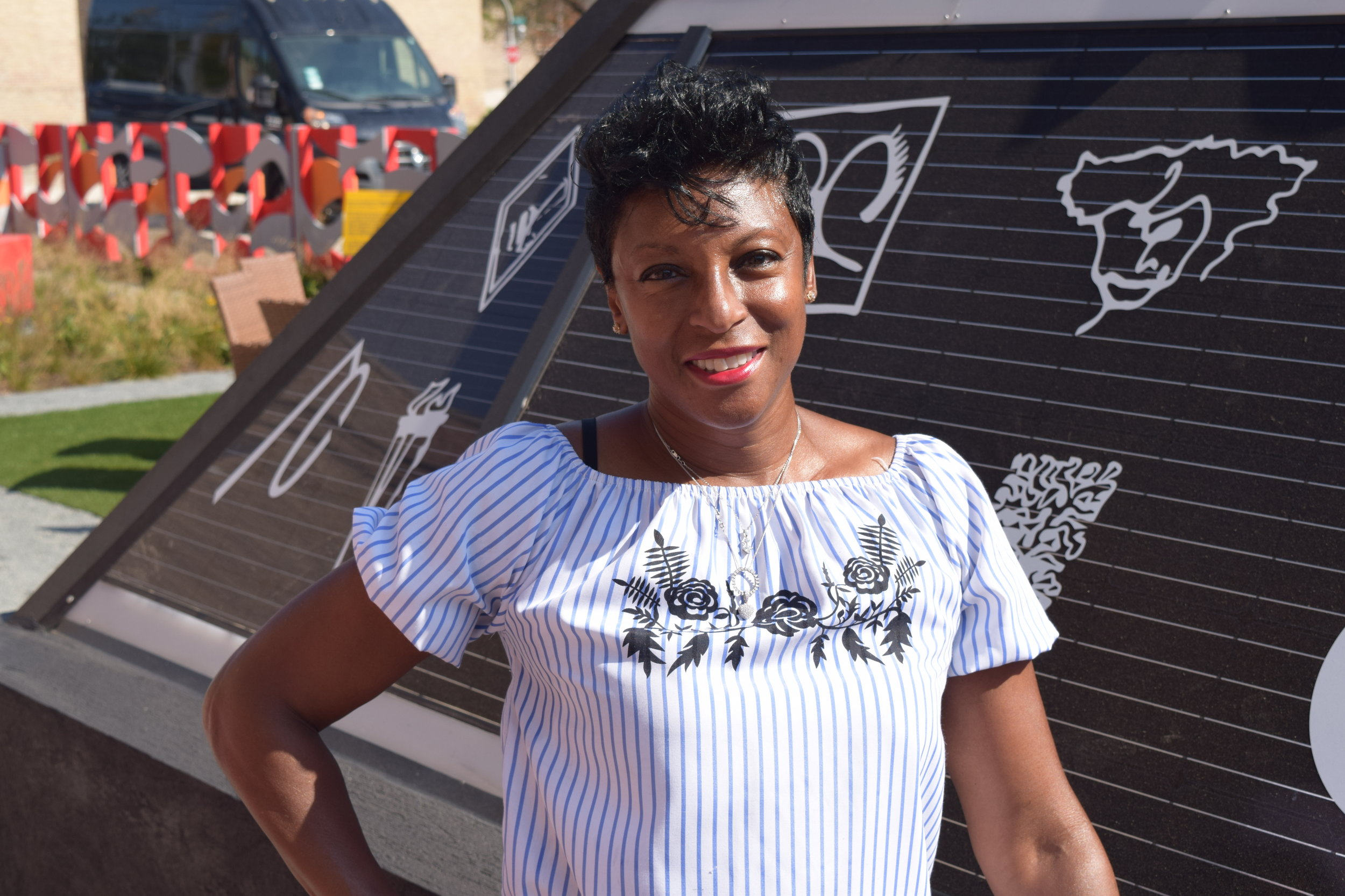 """Frances Guichard     Co-owner, Gallery Guichard   """"We've been in business since 2005. Originally, we were located at 35th and King Dr. We moved here in 2014 to the Bronzeville Artist Lofts. Gallery Guichard is one of the commercial spaces in the bottom level. There are two floors above us that are artist live/work spaces. Our mission is to expose artists to collectors – artists from all over the world - artists of all nationalities, but we specialize in the art of the African Diaspora. It gives artists an opportunity to be creative and imaginative in bringing their works out and us to be able to help them reach an audience that they would not ordinarily reach. We're doing great things in the community, and we're very proud to be here…Because our ancestors came from the South fleeing Jim Crow and other atrocities, they came here for a better way of life, they were able to turn lemons into lemonade. You had a myriad of people who came and really made a better life for themselves. You had your upper, middle, and lower income all living and working together, supporting each other because they couldn't go anywhere else. Because of redlining. African-Americans made this a place where the dollar changed hands on a regular basis and kept the money within the community."""""""