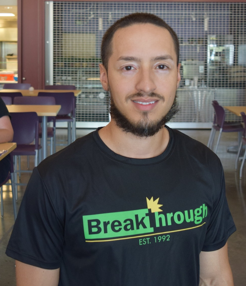 "Eric Estrada   Operations Coordinator, Breakthrough   ""Everything we do comes from a family orientation. A lot of employees are residents of the community, [and the same for me] being part of the community for little over a year and half now and living in the same community, knowing that all my efforts are alongside my neighbors. Breakthrough is here to try to bridge those gaps, even for those from different demographics that are moving in now. There's a community that's already existing in this neighborhood, and we should come up alongside of it. I grew up in Humboldt Park five minutes from here, but it's the same in every community - you get people who just want to see it flourish. Breakthrough is here to be a resource for anyone we can help."""