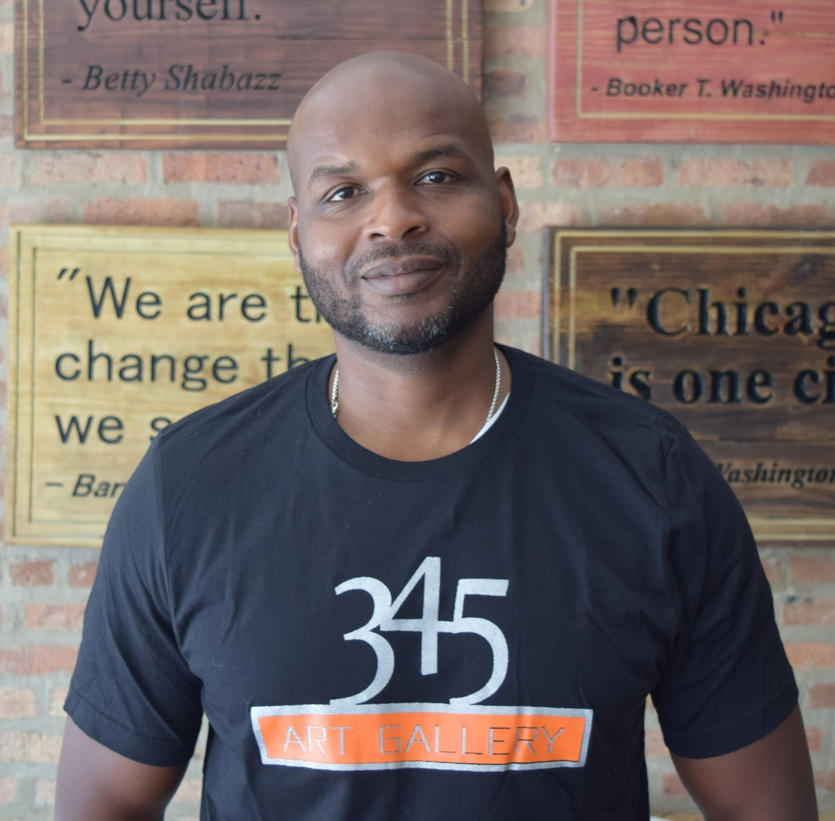 "Corry Williams    Owner, 345 Gallery   ""I've been here three years now. This space used to be a church and was converted to an art gallery. It was one of the first art galleries on the West Side of Chicago. I was born and raised on the West Side. Our neighborhood needed a venue that represents positive energy, a place where our young artists can display their talents and express themselves through their art. I've been collecting art for twenty years now, and it's part of my passion. I wanted to bring it to a neighborhood that's usually talked about in negative ways about the violence that goes on. I hope that I'm a catalyst of that new beginning of what's really going on in East Garfield Park and all the positives…the people and history behind the neighborhood make it great. There are a lot of talented people and a lot of talented artists in our neighborhood that get overlooked because there's no place where they can display their art, visit art shows, and look at other artists work in their neighborhood. The community loves it. They've been very accepting of what we're doing here. We have a lot of collaboration with Breakthrough and all the neighborhood schools with art shows and workshops."