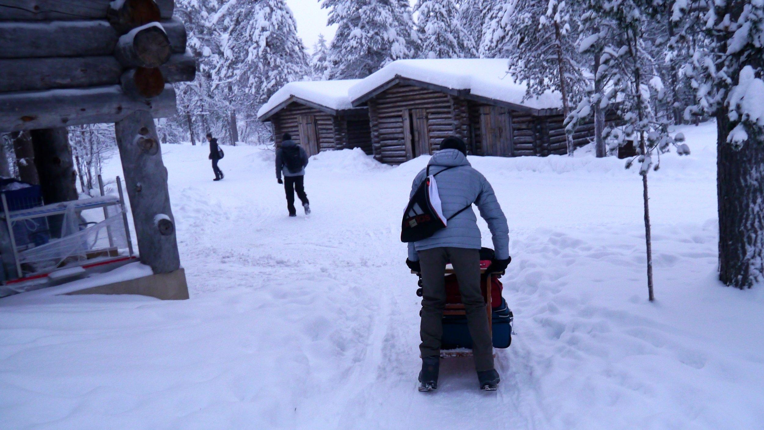 12-22-14 Nathan rides luggage sled copy.jpg
