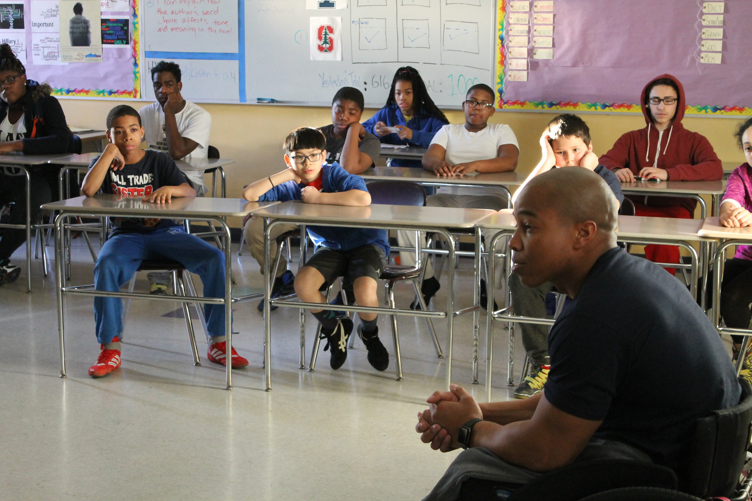 Rohan Murphy speaks to a classroom of BYW student-athletes at the Lilla G Frederick Middle School in Dorchester, MA.