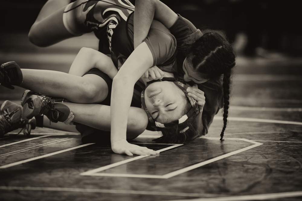 Vanessa Rico (right), a student of East Boston High School and participant in Boston Youth Wrestling, at a February 2016 competition. Photograph: Jared Charney