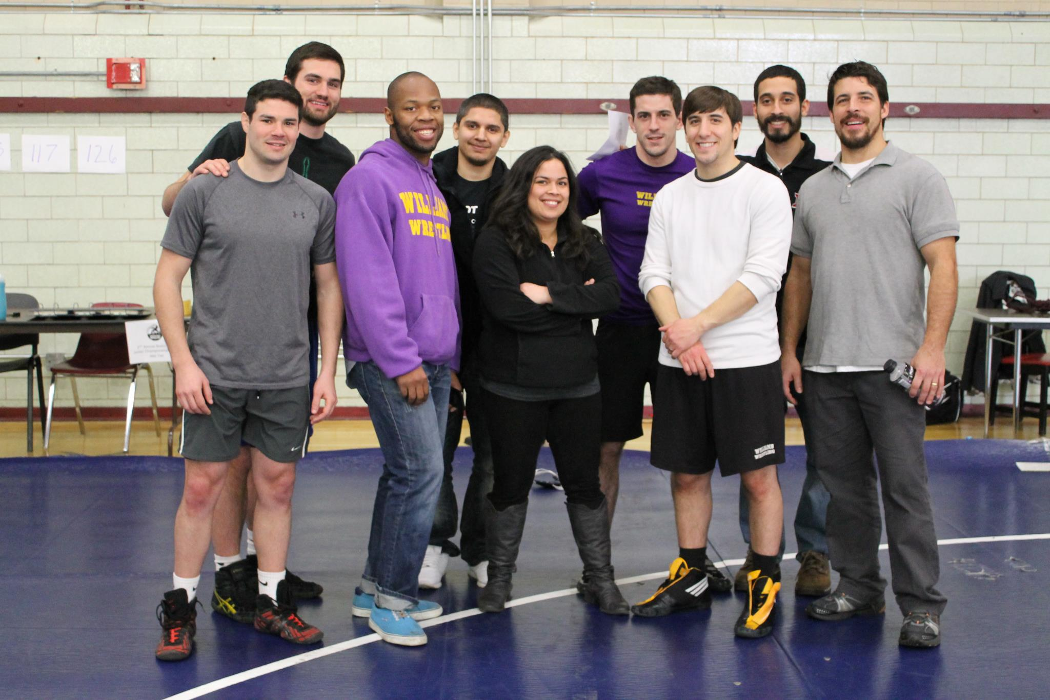 Bior (pictured here in middle) with volunteers, board members, and coaches at the conclusion of the Boston City Championships on January 20, 2013 at TechBoston Academy (Dorchester).
