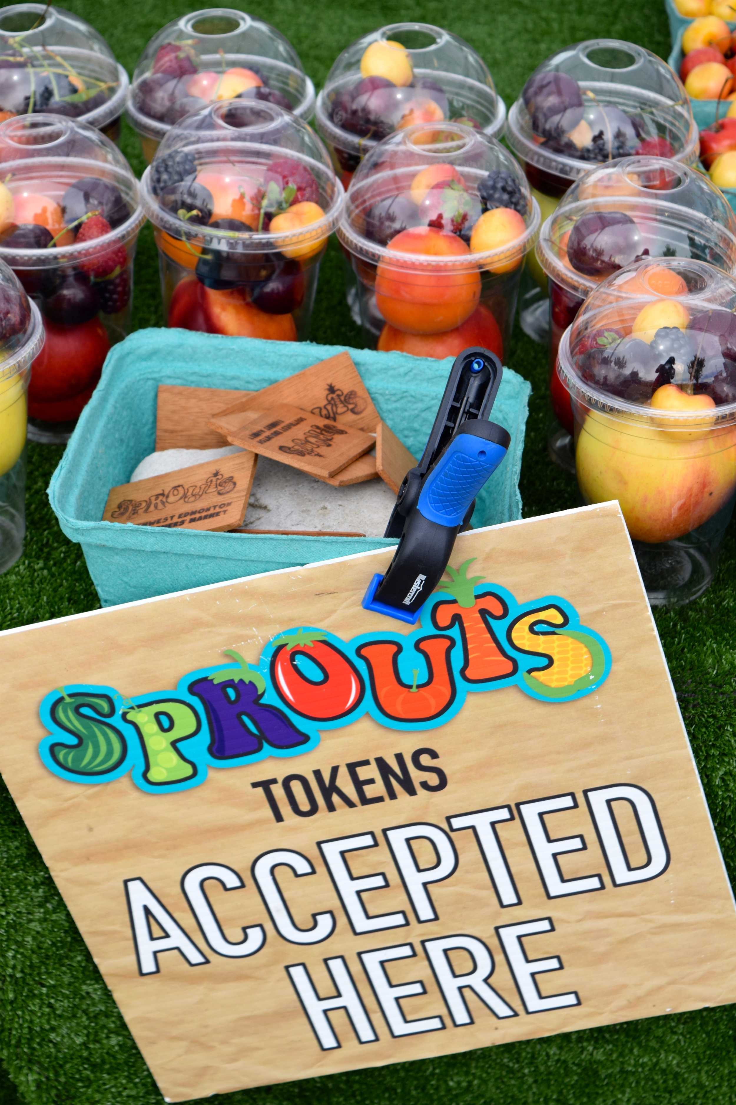 This week's photo of the week features the most-loved signs at the market! Our little Sprouts look out for these brightly coloured signs for places where they can spend their Sprouts tokens... Often on pre-made mixed cups of fruits and veg just for kids!