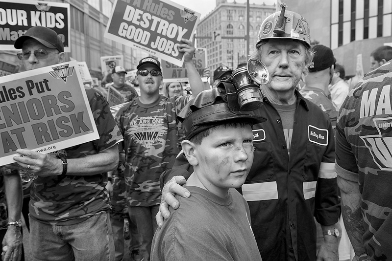 United Mine Worker Floyd Macheska from West Newton, PA, and his grandson Stephen Macheska, nine, from Belle Vernon, PA, watch as fourteen members of the United Mine Workers of America are arrested after refusing to move from the steps of the Federal Building. Some 5,000 union members led by the UMWA marched to protest stricter pollution rules for coal-burning power plants proposed by the EPA...  © Scott Goldsmith/TDW 2014