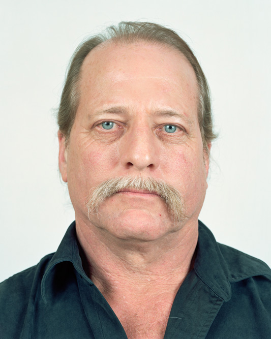 """Jeff T. Bond poses for a portrait in Senecaville, Ohio on 02/19/2016. Bond, who has lived in Seneca Township for 35 years with his wife Kerri, claims that energy companies and state officials are harassing them and covering up the theft of gas and mineral leases on their property. The dispute, which began in 2011, is still not resolved. He also claims that air and water pollution are affecting his health. Bond says he has experienced respiratory and other problems. """"Our land is not safe anymore."""" Bond said, """"Things aren't the same and we can't get anyone to acknowledge the problems.""""©Noah Addis/MSDP 2015"""