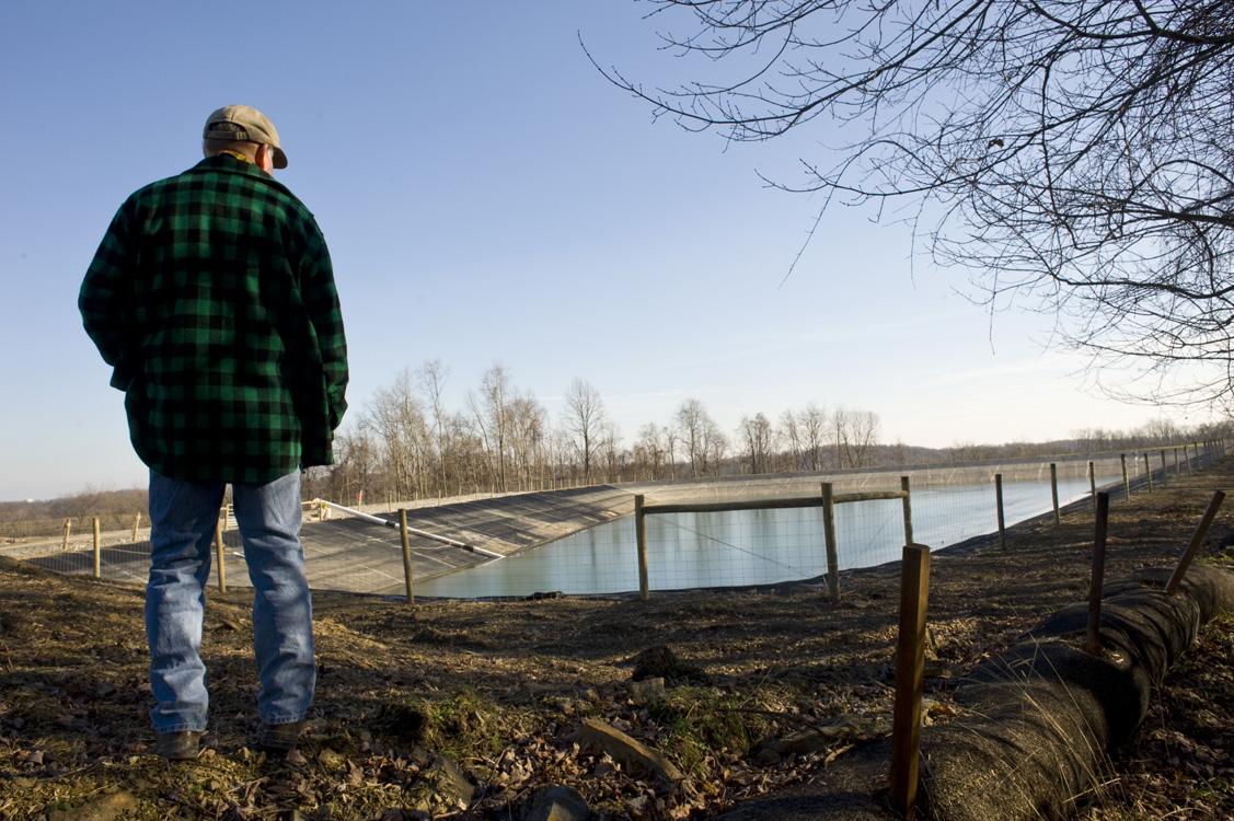 A landowner observes a freshwater impoundment built by EQT near the edge of his farm in Greene County. ©  Martha Rial/MSDP 2012